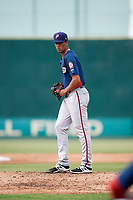 Potomac Nationals starting pitcher Joan Baez (18) gets ready to deliver a pitch during the first game of a doubleheader against the Lynchburg Hillcats on June 9, 2018 at Calvin Falwell Field in Lynchburg, Virginia.  Lynchburg defeated Potomac 5-3.  (Mike Janes/Four Seam Images)