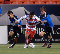 FC Dallas forward Ramon Nunez fends off tackles from Colorado's Pablo Mastroeni and Terry Cooke. The Colorado Rapids drew 0-0 with FC Dallas in the first game of the Western Conference Semi-finals Invesco Field at Mile High, Denver, Colorado, September 22, 2005.