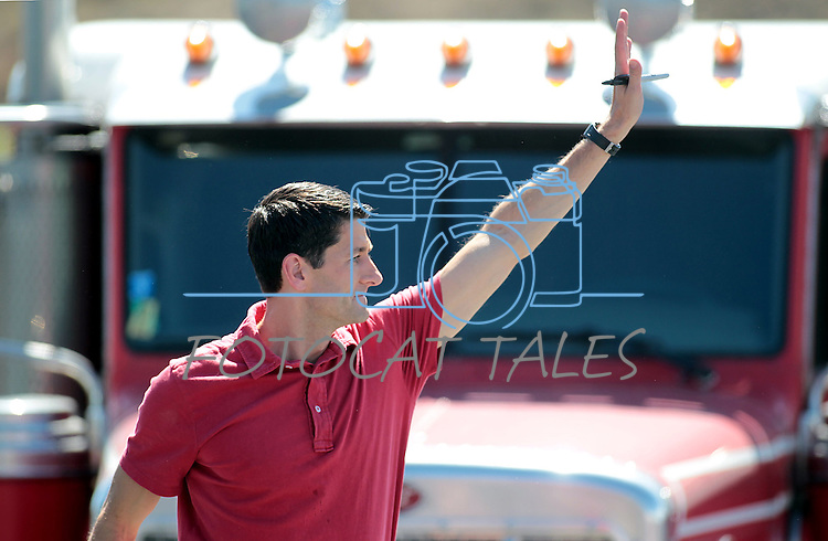 Republican Vice-Presidential candidate Rep. Paul Ryan, R-Wis., greets the crowd after a campaign stop at the Peterbilt Truck & Parts Equipment company in Sparks, Nev., on Friday, Sept. 7, 2012. (AP Photo/Cathleen Allison)