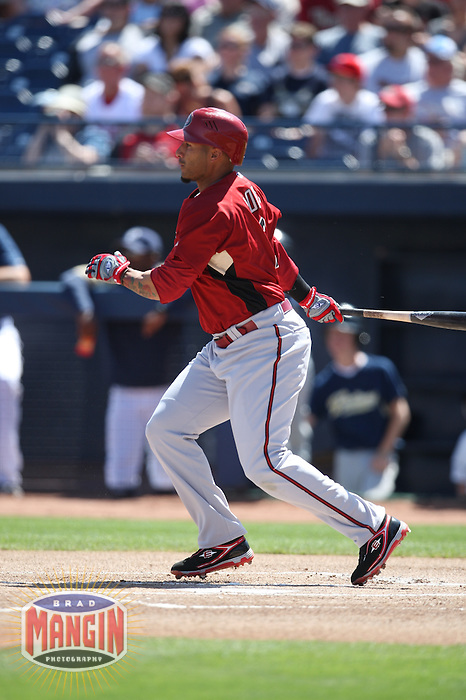 PEORIA, AZ - MARCH 22:  Felipe Lopez of the Arizona Diamondbacks bats during a spring training game against the San Diego Padres at the Peoria Sports Complex in Peoria, Arizona on March 22, 2009.  Photo by Brad Mangin