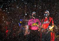 Nov 1, 2020; Las Vegas, Nevada, USA; NHRA pro stock driver Erica Enders celebrates with crew member Rickie Jones Jr after winning the NHRA Finals and the 2020 pro stock World Championship at The Strip at Las Vegas Motor Speedway. Mandatory Credit: Mark J. Rebilas-USA TODAY Sports