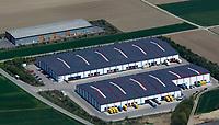 aerial photograph of warehouse roofs covered with solar panels, Bavaria, Germany | Luftaufnahme von mit Sonnenkollektoren bedeckten Lagerhallendächern, Bayern, Deutschland