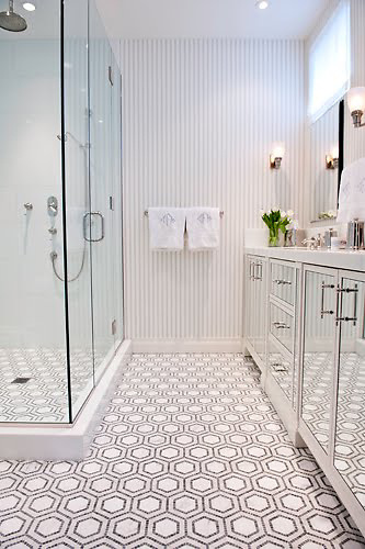 This custom bathroom features Honeycomb, a handmade mosaic shown in polished Thassos, Bardiglio and honed Calacatta from New Ravenna.<br /> <br /> For pricing samples and design help, click here: http://www.newravenna.com/showrooms/