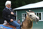 June 5, 2015: Bob Baffert rides his pony, Smokey , outside the barn while waiting for American Pharoah to come out for his bath. Belmont Park, Elmont, NY. Joan Fairman Kanes/ESW/CSM