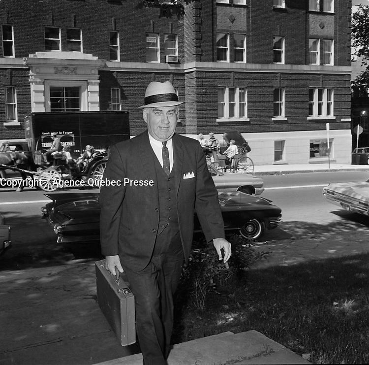 Le depute de l'Union Nationale Maurice Bellemare, le 19 aout 1964, dans la ville de Quebec.<br /> <br /> PHOTO : Agence Quebec Presse  - Photo Moderne