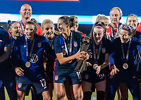 FRISCO, TX - MARCH 11: Carli Lloyd #10 of the United States raises the trophy during a game between Japan and USWNT at Toyota Stadium on March 11, 2020 in Frisco, Texas.