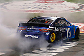 #19: Martin Truex Jr., Joe Gibbs Racing, Toyota Camry Auto Owners Insurance celebrates his win with a burnout