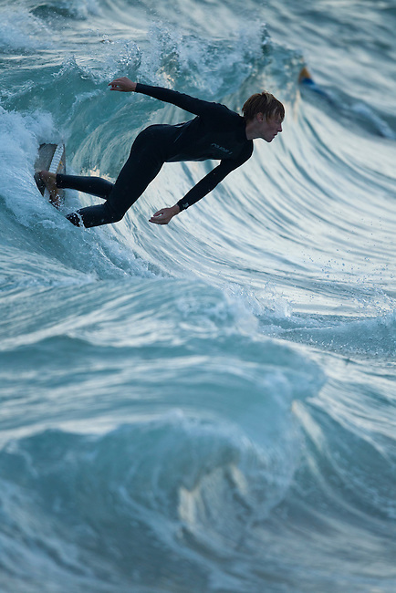 Skyler S. catches a beautiful wave while surfing at The Wedge, Newport Beach , Sep. 22, 2011.