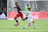 WASHINTON, DC - FEBRUARY 29: Washington, D.C. - February 29, 2020: Ulises Segura #8 of D.C. United battles the ball with Jack Price #19 of the Colorado Rapids. The Colorado Rapids defeated D.C. United 2-1 during their Major League Soccer (MLS)  match at Audi Field during a game between Colorado Rapids and D.C. United at Audi FIeld on February 29, 2020 in Washinton, DC.