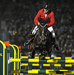 9 October 2010: Gold medalist Philippe Le Jeune clears his final jump during the Rolex Top Four Jumping Finals in the World Equestrian Games in Lexington, Kentucky
