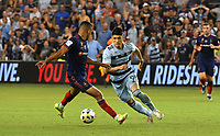 KANSAS CITY, KS - SEPTEMBER 11: Alan Pulido #9 of Sporting Kansas City dribbles around Miguel Navarro #6 of Chicago Fire FC during a game between Chicago Fire FC and Sporting Kansas City at Children's Mercy Park on September 11, 2021 in Kansas City, Kansas.