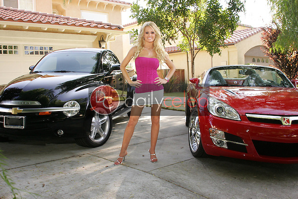 Katie Lohmann<br /> posing with her vehicles in a photo shoot for Celebrity Car Magazine, Private Location, Los Angeles, CA 09-04-05 Exclusive<br /> David Edwards/DailyCeleb.com 818-249-4998