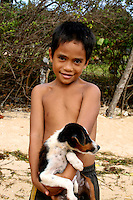 Child With Puppy outside the Tongan Beach Resort, Tonga