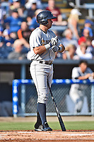 Charleston RiverDogs left fielder Michael O'Neill #10 during a game against the Asheville Tourists at McCormick Field July 26, 2014 in Asheville, North Carolina. The RiverDogs defeated the Tourists 8-7. (Tony Farlow/Four Seam Images)