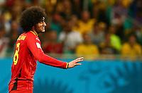 Marouane Fellaini of Belgium gestures an apology to a team mate