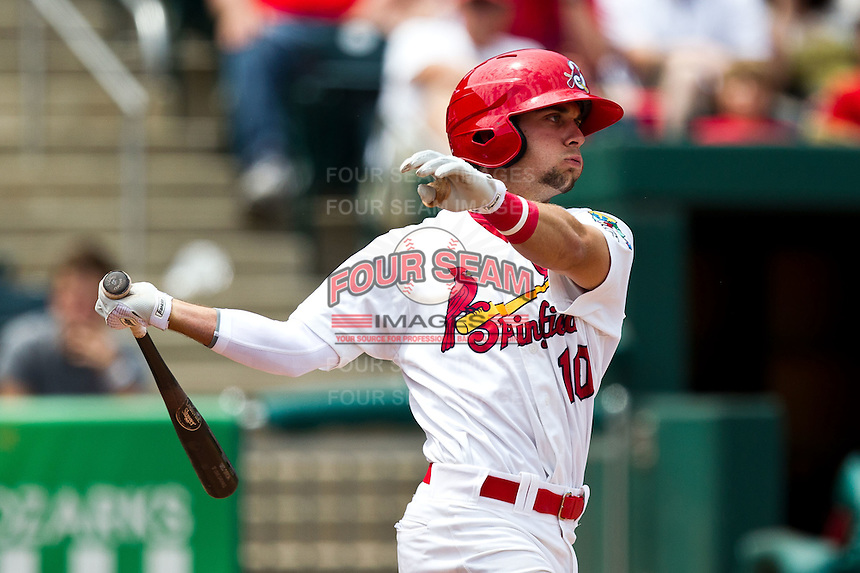 Greg Garcia (10) of the Springfield Cardinals follows through his swing during a game against the Arkansas Travelers at Hammons Field on May 8, 2012 in Springfield, Missouri. (David Welker/ Four Seam Images)