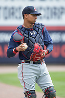 Gwinnett Braves catcher Christian Bethancourt (38) warms up in the outfield prior to the game against the Charlotte Knights at BB&T BallPark on July 3, 2015 in Charlotte, North Carolina.  The Braves defeated the Knights 11-4 in game one of a day-night double header.  (Brian Westerholt/Four Seam Images)