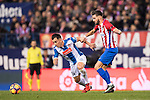 Jose Manuel Jurado Marin of RCD Espanyol battles for the ball with Yannick Ferreira Carrasco of Atletico de Madrid during the La Liga match between Atletico de Madrid and RCD Espanyol at the Vicente Calderón Stadium on 03 November 2016 in Madrid, Spain. Photo by Diego Gonzalez Souto / Power Sport Images