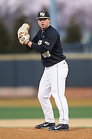 Wake Forest Demon Deacons relief pitcher Nate Jones (42) looks to his catcher for the sign against the Georgetown Hoyas at Wake Forest Baseball Park on February 16, 2014 in Winston-Salem, North Carolina.  The Demon Deacons defeated the Hoyas 3-2.  (Brian Westerholt/Four Seam Images)