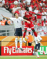 Kewyne Jones of Trinidad gets higher than John Terry of England on this header. England defeated Trinidad & Tobago 2-0 in their FIFA World Cup group B match at Franken-Stadion, Nuremberg, Germany, June 15 2006.