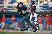 Umpire Scott Molloy gets in position as catcher Pablo Garcia (7) watches the play during a game between the Williamsport Crosscutters and Batavia Muckdogs on September 1, 2016 at Dwyer Stadium in Batavia, New York.  Williamsport defeated Batavia 10-3. (Mike Janes/Four Seam Images)