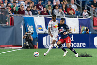 FOXBOROUGH, MA - JUNE 23: Gustavo Bou #7 of New England Revolution pressures Kyle Duncan #6 of New York Red Bulls during a game between New York Red Bulls and New England Revolution at Gillette Stadium on June 23, 2021 in Foxborough, Massachusetts.