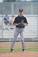 Grand Junction Rockies relief pitcher Jared Skolnicki (25) checks the runner at first base during a Pioneer League game against the Helena Brewers at Kindrick Legion Field on August 19, 2018 in Helena, Montana. The Grand Junction Rockies defeated the Helena Brewers by a score of 6-1. (Zachary Lucy/Four Seam Images)