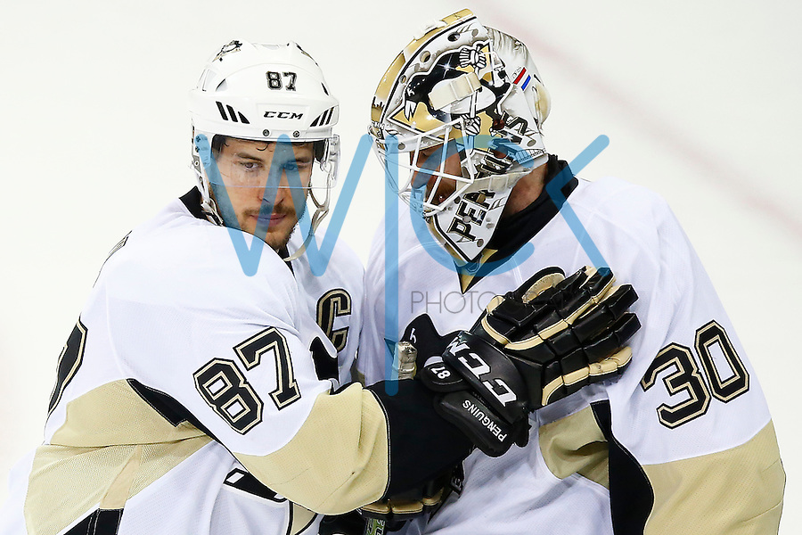 Sidney Crosby #87 congratulates teammate Matt Murray #30 of the Pittsburgh Penguins on his 5-0 shutout win against the New York Rangers during game four of the first round of the Stanley Cup Playoffs at Madison Square Garden in New York City on April 21, 2016. (Photo by Jared Wickerham / DKPS)