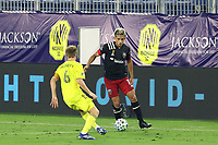 NASHVILLE, TN - SEPTEMBER 23: Yamil Asad #11 of DC United is defended by Dax McCarty #6 of Nashville SC during a game between D.C. United and Nashville SC at Nissan Stadium on September 23, 2020 in Nashville, Tennessee.