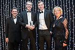 © Joel Goodman - 07973 332324 . 05/03/2015 .  Midland Hotel , Manchester , UK . L-R Eamonn O'Neill , winner Jonathan Watkins of DLA Piper , sponsor (Douglas Scott Legal Recruitment) and Louise Straw . Corporate / Commercial Team of the Year . The Manchester Legal Awards 2015 . Photo credit : Joel Goodman