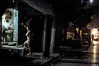 A rural migrant bathes on the street at midnight in the southwestern Chinese megapolis of Chongqing. Migrants often work through the nights. For many, this is a long and arduous step in the transition from farming to urban living. China is hoping by relocating farmers into cities they would start to buy food, making a break from the cycle of farmers consuming only what they produce. The Chinese government plans to move 250 million rural residents into urban areas over the coming dozen years though it is unclear whether people want to move and where the money for this project will come from. Further urbanisation is meant to drive up consumption to counterbalance an export orientated economy and end subsistence farming but the drive to get people off the land is causing tens of thousands of protests each year. /Felix Features