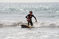 Tom , young boy surfing a foam surfboard at Godrevy , Cornwall , July 2011 pic copyright Steve Behr / Stockfile