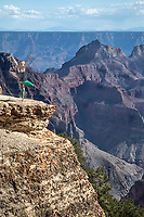 A woman is entranced by the immense beauty of the Grand Canyon at The North Rim, Arizona