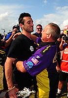 Apr. 29, 2012; Baytown, TX, USA: NHRA pro stock driver Vincent Nobile (left) celebrates with father John Nobile after winning the Spring Nationals at Royal Purple Raceway. Mandatory Credit: Mark J. Rebilas-