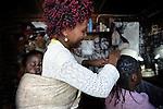 Coiffeuse dans un bidonville de Mbabane.Le Swaziland est l'un des plus pauvre du monde et offre un contraste frappant avec les frasques et les dépenses somptuaires du Roi Mswati III.<br /> <br /> Grand mère swazi.Le Swaziland est l'un des plus pauvre du monde et offre un contraste frappant avec les frasques et les dépenses somptuaires du Roi Mswati III.<br /> <br /> Paysanne dans les montagnes du Swaziland. le pays est l'un des plus pauvre du monde et offre un contraste frappant avec les frasques et les dépenses somptuaires du Roi Mswati III.<br /> <br /> <br /> Swazi hair dresser with her baby in her home. Mostly agricultural, the kingdom is one of the poorest in the world and offers a striking contrast to lavish spending of King Mswati III.