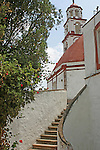 Exterior detail of staircase dome and belltower at Santuario del Sacromonte (a religious sanctuary) in Amecameca, Mexico state, Mexico - important pilgrimage site built over cave retreat of 16th century Dominican friar