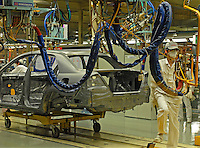 A worker on the production line of the Honda Accord at the new Guangzhou Honda Automobile Co. Ltd. factory. The plant built at a cost of 140 million US$ is one of the most advanced car plants in the world. It has a state of the art production line as well as the world's first total water re-cycling sytem.