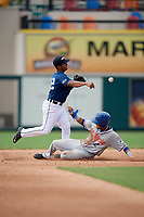 Lakeland Flying Tigers shortstop Junnell Ledezma (12) turns a double play as St. Lucie Mets shortstop J.C. Rodriguez (2) slides into second base during a game against the St. Lucie Mets on June 11, 2017 at Joker Marchant Stadium in Lakeland, Florida.  Lakeland defeated St. Lucie 1-0.  (Mike Janes/Four Seam Images)