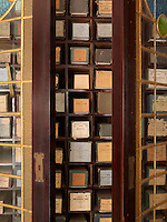 A cabinet built to house a collection of music, each neatly stored in its individual square niche