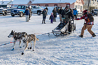 Ray Redington Jr. gets a high-five as he runs on Front Street in Nome on the way to the a 4th place finish on Wednesday March 14th in the 46th running of the 2018 Iditarod Sled Dog Race.  <br /> <br /> Photo by Jeff Schultz/SchultzPhoto.com  (C) 2018  ALL RIGHTS RESERVED