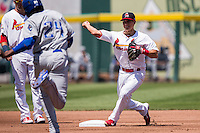 Greg Miclat (3) of the Springfield Cardinals steps on second and throws to first to turn a double play during a game against the Tulsa Drillers at Hammons Field on May 4, 2014 in Springfield, Missouri. (David Welker/Four Seam Images)