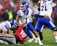 ATHENS, GA - OCTOBER 19: Lynn Bowden Jr. #1 of the Kentucky Wildcats evades the Georgia pass rush during a game between University of Kentucky Wildcats and University of Georgia Bulldogs at Sanford Stadium on October 19, 2019 in Athens, Georgia.