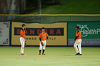 AZL Giants outfielders Aaron Bond (38), Ismael Munguia (29), and Mikey Edie (16) talk while a pitching change is made during a game against the AZL Rangers on August 22 at Scottsdale Stadium in Scottsdale, Arizona. AZL Rangers defeated the AZL Giants 7-5. (Zachary Lucy/Four Seam Images via AP Images)