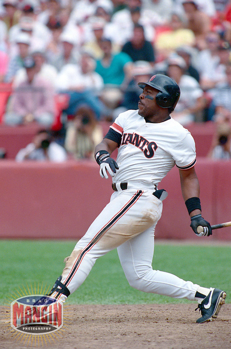 SAN FRANCISCO, CA - Kevin Mitchell of the San Francisco Giants hits a game winning home run during a game against the Cincinnati Reds at Candlestick Park in San Francisco, California in 1990. Photo by Brad Mangin
