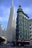 San Francisco, California - Transamerica Building and Columbus Tower Building.  The building on the right is also called the Sentinel Building.  It was one of San Francisco's first skyscrapers.  The green color is oxidized copper.  The base of the Transamerica building shows design features incorporated to render the building less susceptible to earthquake damage.  The Transamerica pyramid was opened in 1972.