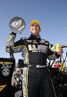 Apr. 7, 2013; Las Vegas, NV, USA: NHRA top fuel dragster driver Tony Schumacher celebrates after winning the Summitracing.com Nationals at the Strip at Las Vegas Motor Speedway. Mandatory Credit: Mark J. Rebilas-