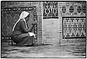 Uzbekistan - Tashkent - An uzbek woman is praying in fron of Zengi Ata mausoleum.