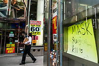 NEW YORK, NY - AUGUST 8: A woman walks near a retail store closing in Times Square on August 8, 2020 in New York City. With more than four months NYC has closed some of their doors to combat the coronavirus, putting its vital tourism industry paralyzed with a moribund economy, where business and leaders are trying to revive an industry that brought in $45 billion annually and supported more than 300,000 jobs. (Photo by Eduardo MunozAlvarez/VIEWpress)