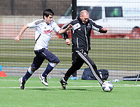 Thursday 11 April 2013<br /> Pictured: Goalkeeping coach Adrian Tucker (R) against a sports reporter.<br /> Re: Friendly game, Swansea City FC coaching staff v sports reporters at the Swansea City FC training ground. Final score 10-4.