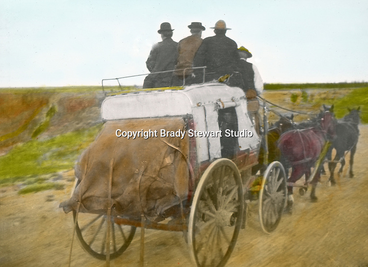 Jerome ID:  Brady Stewart and friends riding into town for food and beverage.  Brady Stewart and three friends went to Idaho on a lark from 1909 thru early 1912.  As part of the Mondell Homestead Act, they received a grant of 160 acres north of the Snake River.  Brady Stewart photographed the adventures of farming along with the spectacular landscapes. To give family and friends a better feel for the adventure, he hand-color black and white negatives into full-color 3x4 lantern slides.  The Process:  He contacted a negative with another negative to create a positive slide.  He then selected a fine brush and colors and meticulously created full-color slides.